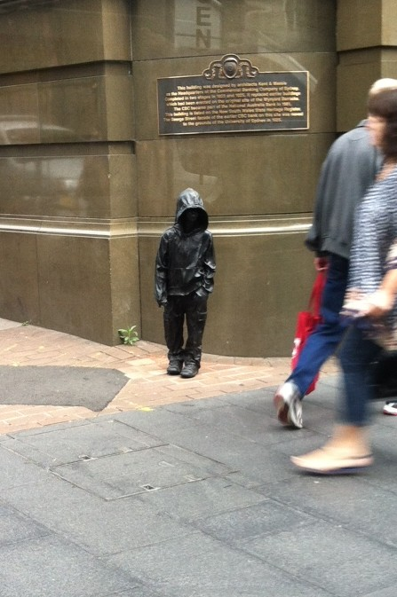 little guy statue